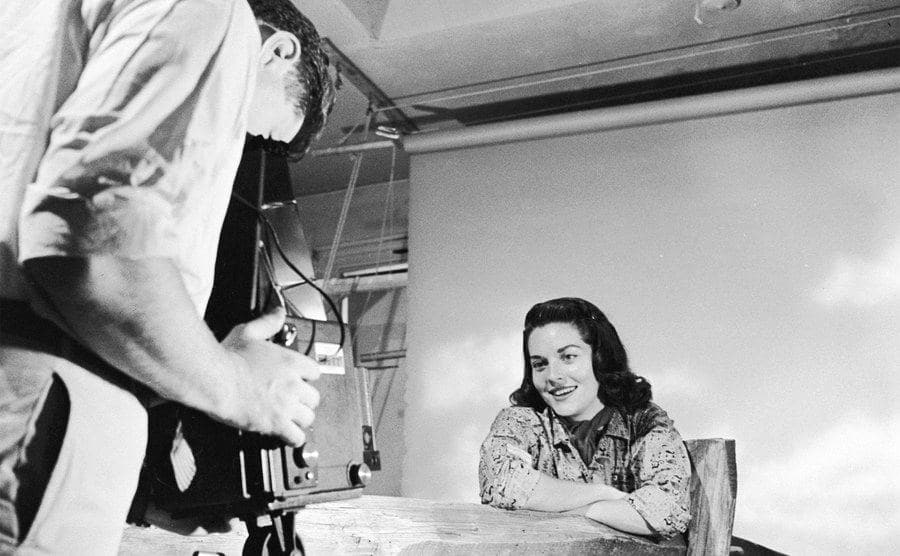 A photographer takes a studio portrait of Lee Meriwether.