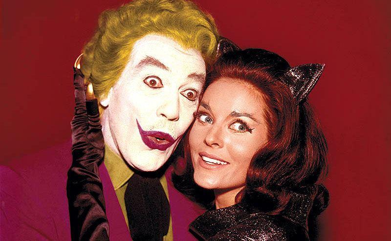 Caesar Romero, as the Joker, embraces Lee Meriwether as Catwoman.