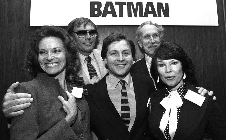 The cast of Batman poses together during an event.