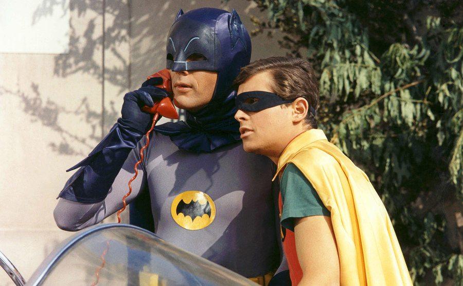 Adam West, as Batman, and Burt Ward, as Robin, in a still from the TV show.