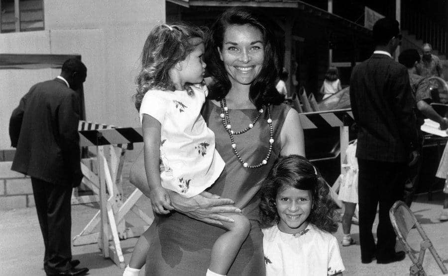 Lee Meriwether and her two daughters at a children's party.