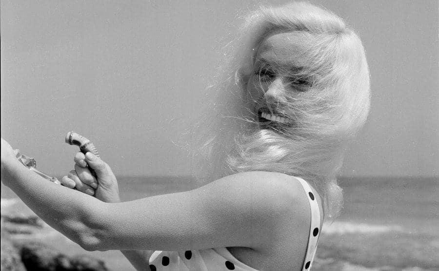Mamie Van Doren poses at the beach.