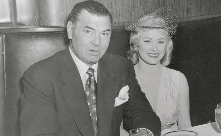 Van Doren and Jack Dempsey are sitting at a dinner table.