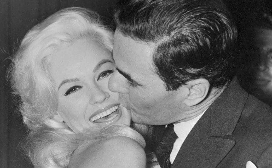 An admirer kisses Mamie Van Doren.