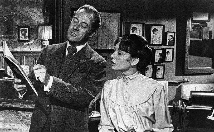 Audrey Hepburn as Eliza Doolittle and Rex Harrison as Professor Henry Higgins.