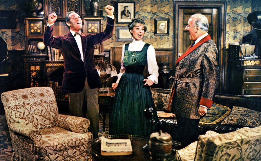 Rex Harrison, Audrey Hepburn, and Wilfrid Hyde-White in a scene from My Fair Lady.