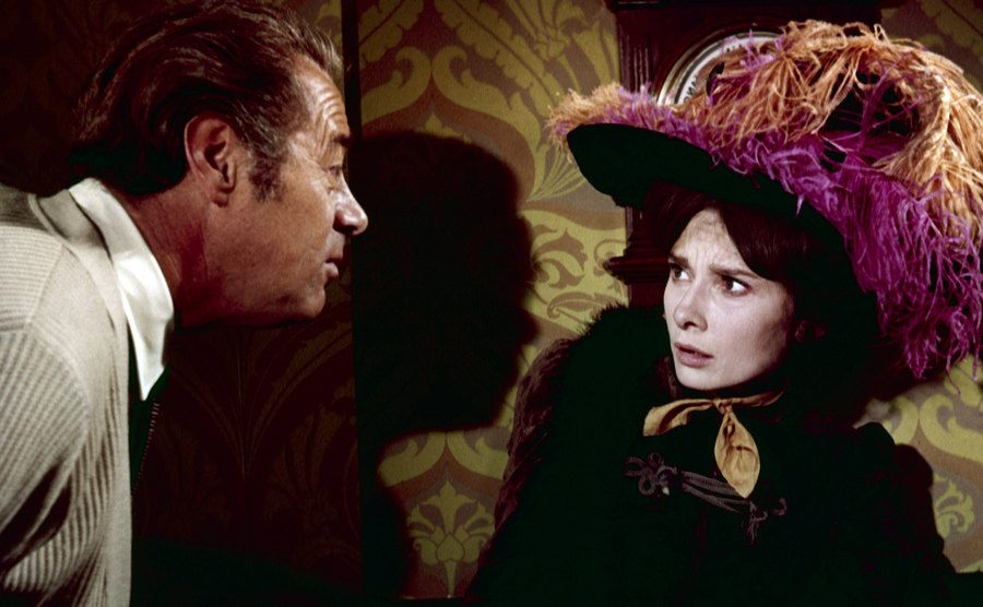 Rex Harrison and Audrey Hepburn appear in a scene from 'My Fair Lady'