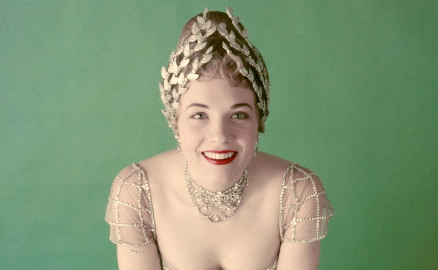 Julie Andrews is wearing her ballgown from the stage musical 'My Fair Lady.'