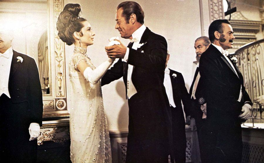 Audrey Hepburn dances with Rex Harrison in a scene from My Fair Lady