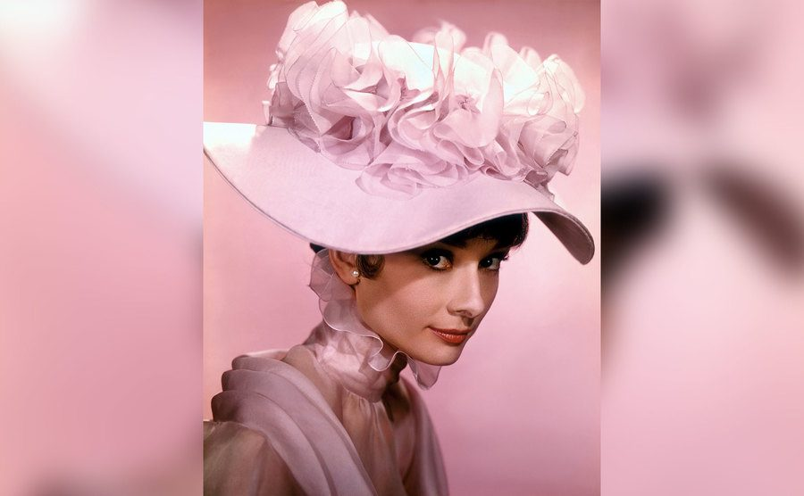 Audrey Hepburn poses for a portrait in her My Fair Lady costume.
