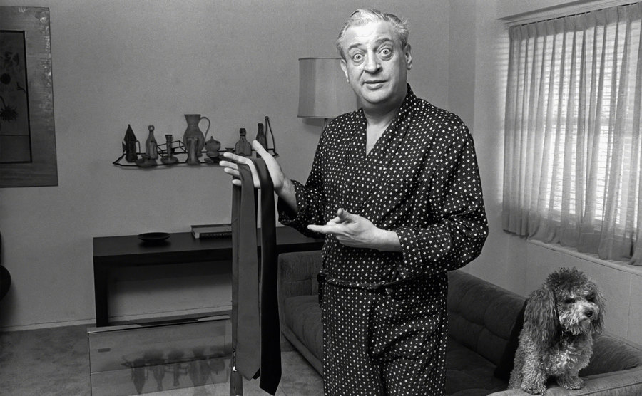 Rodney Dangerfield is deciding on a tie in his apartment.