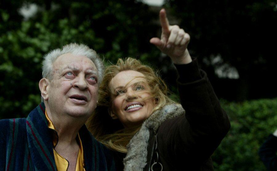 Rodney Dangerfield looks skyward with his wife, Joan.