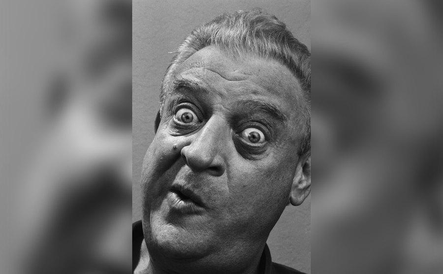 A headshot of Rodney Dangerfield making a funny face.