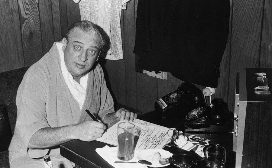 Rodney Dangerfield looks up as he reviews his jokes for the evening's performance.