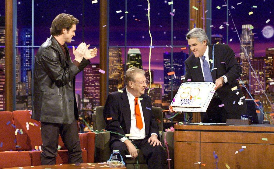 Jim Carrey helps Rodney Dangerfield celebrate his 80th birthday on