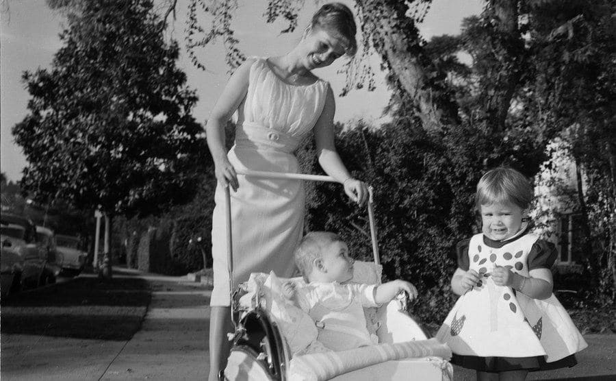 Debbie Reynolds takes a walk with her children Carrie Fisher and Todd Fisher.
