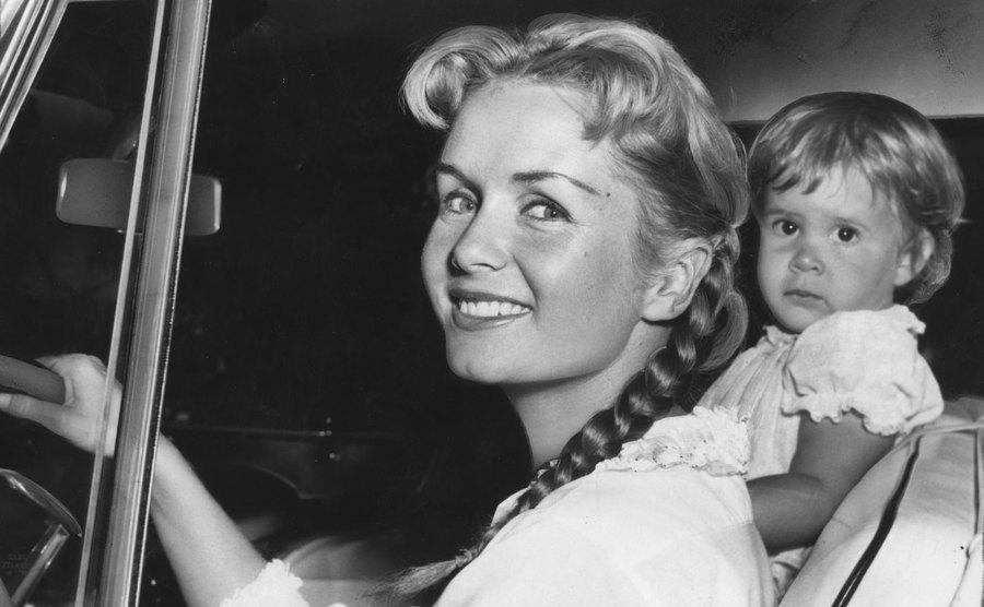 Debbie Reynolds and Carrie Fisher are in their car as they leave the house.