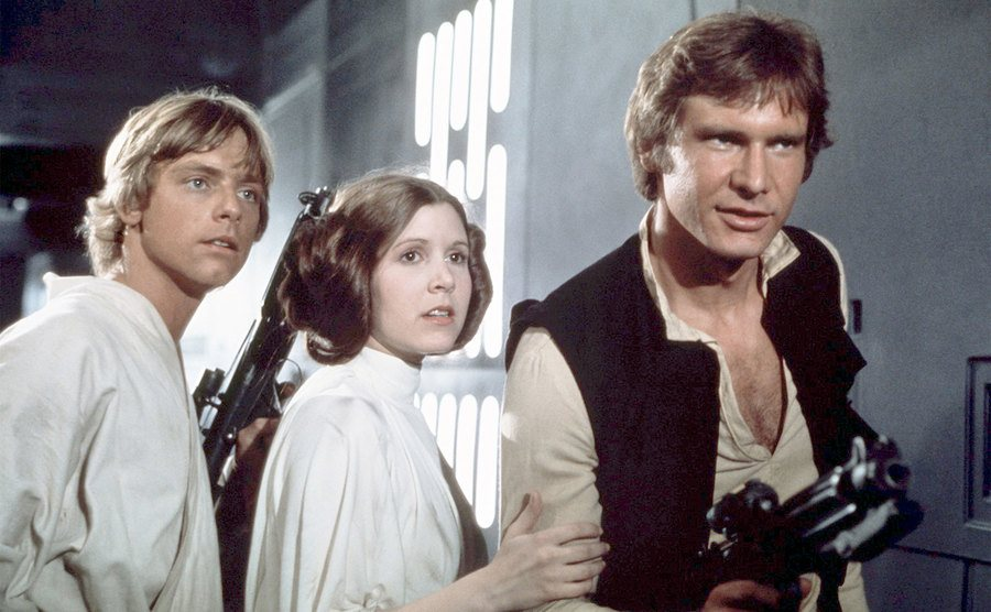 Mark Hamill, Carrie Fisher, and Harrison Ford on the set of Star Wars: Episode IV.