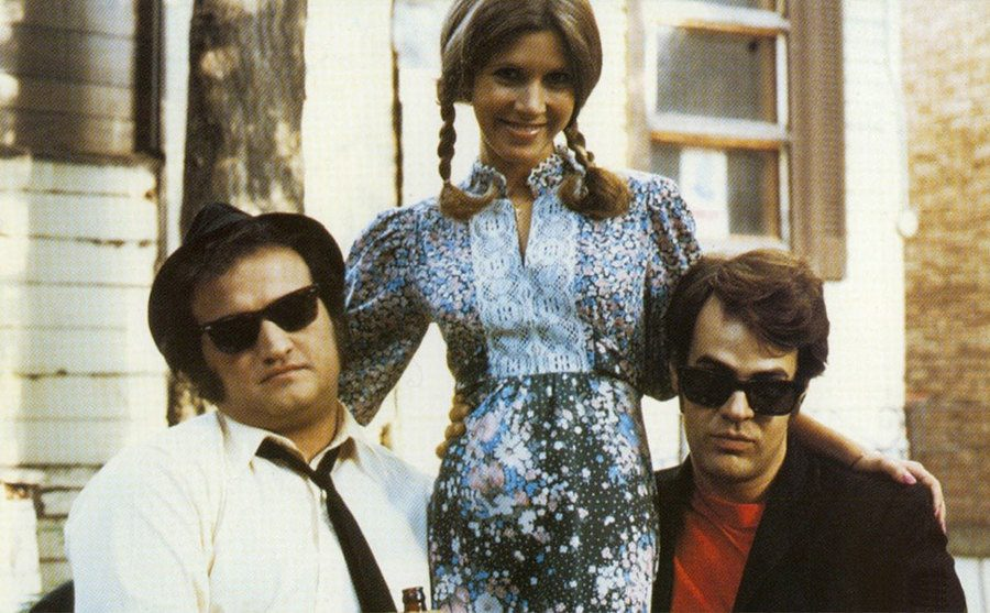 John Belushi, Carrie Fisher, and Dan Aykroyd on the set of The Blues Brothers.