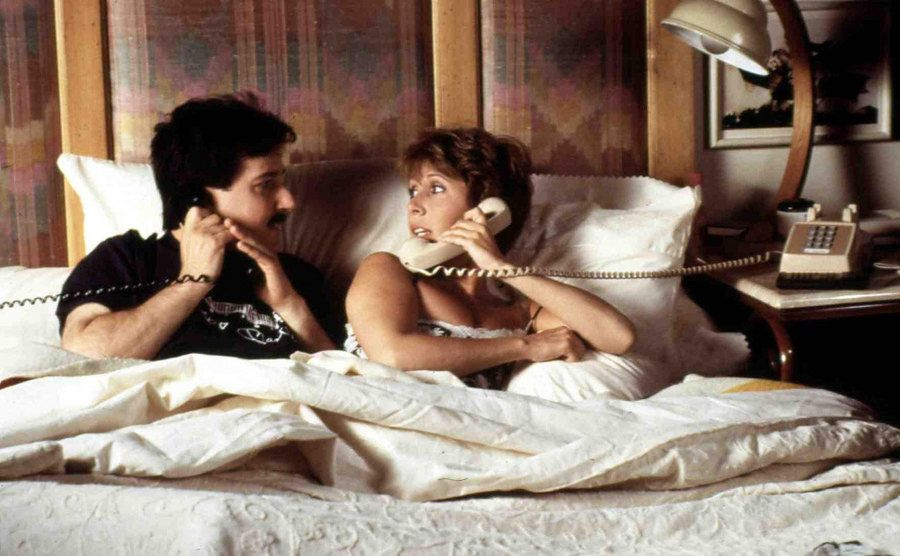 Carrie Fisher and Bruno Kirby in a scene from When Harry Met Sally…