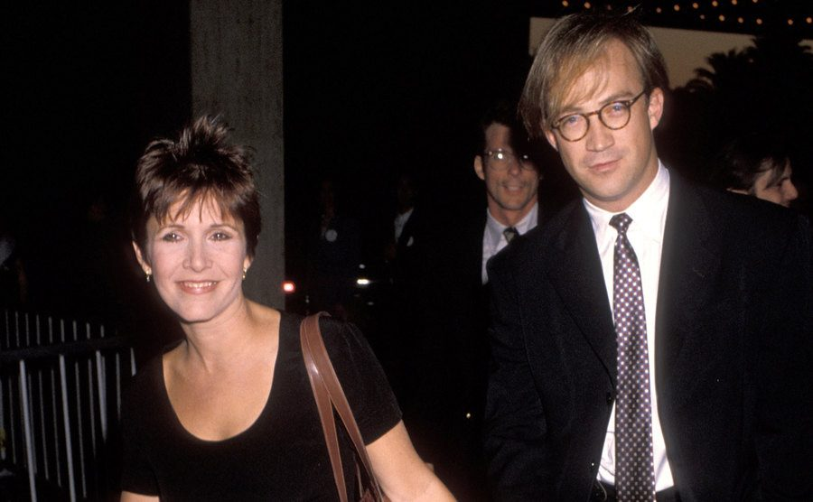 Carrie Fisher and Bryan Lourd arrive at an event.
