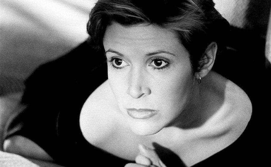 Carrie Fisher poses for a photoshoot.