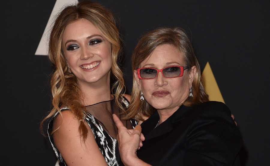 Carrie Fisher and Billie Catherine Lourd attend an event.